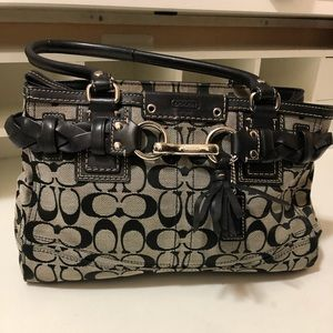 Coach bag. Awesome design with hanging tassel
